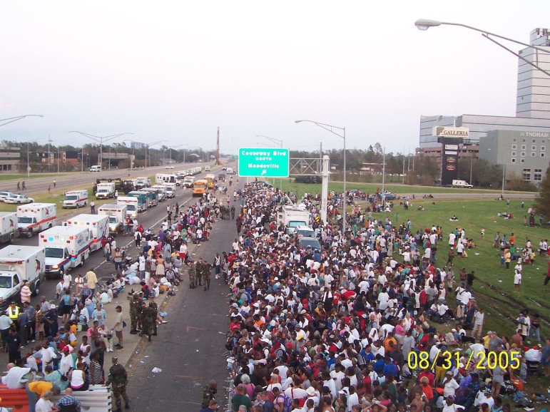 Throngs gather at Causeway Boulevard and I-10 for belated evacuation from the Katrina disaster zone.