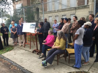Neighbors of the old McDonogh No. 31 school gather at the site Thursday to raise objections to the density of a proposed redevelopment of the building.