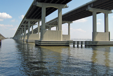 The twin spans link Orleans and St. Tammany parishes, but the bridge is also a barrier.