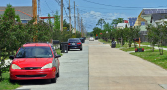 The parking lane on Deslonde Street was paved with a solid but porous concrete mixture. The city said results indicate the practice should be used throughout the city where affordable.