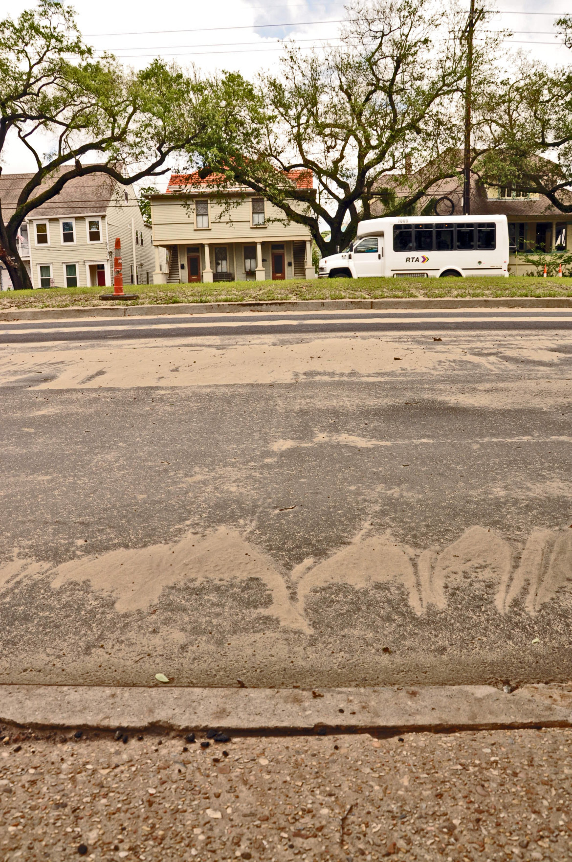The top of the neutral ground being rebuilt on Napoleon Avenue by the Army Corps of Engineers rises far above the sidewalk side of the street in part because it is designed with a crown - meaning the center is higher than the sides. Opponents of the plan wanted the neutral ground to be flat or concave to reduce storm runoff going into the street.