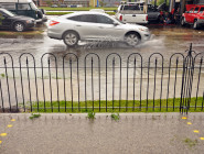 The parking lot at Parkway Bakery and Tavern stays dry as the nearby street takes on water in a recent storm.