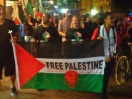 Area residents march in solidarity with Palestinians during the #astreetcarnamedgaza protest August 1, 2014, during Israel's Operation Protective Edge.