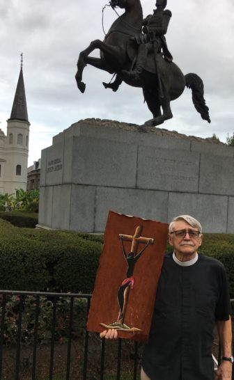 The Rev. Barnwell displays the African Jesus he carried in the march to Jackson Square.