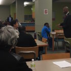 Orleans schools Superintendent Henderson Lewis Jr. speaks to parents and faculty at McDonogh 35 Senior High School. McDonogh 35's principal is one of five starting a new charter network that wants to take over the district's five remaining traditional schools.