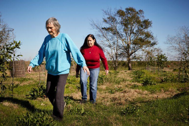 Nazia Dardar (left) and her daughter-in-law Theresa Dardar walk through their garden in Pointe-au-Chien.