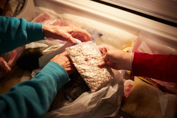 Nazia Dardar handles bags of beans and okra seeds from her freezer in Pointe-au-Chien.