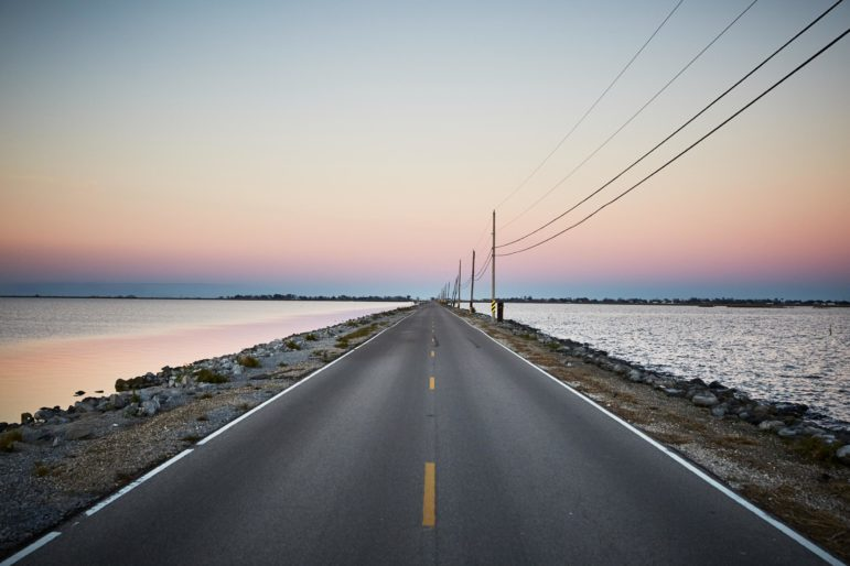 Island Road connects Pointe-au-Chien with Isle de Jean Charles, which has lost 98 percent of its island home since 1955. At high tide, the road is sometimes covered with water, making it impassable for school buses.