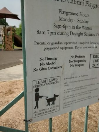 Posted at each entrance to Cabrini, the leash law is widely ignored by dog owners.
